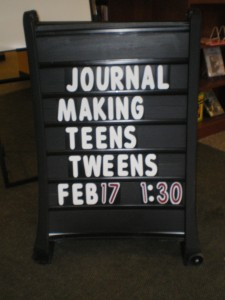 Recycled journal making class sign at the Sixteen Acres library!