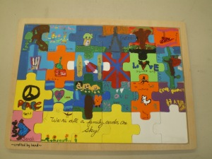 As part of a school auction I had my students create mixed media heritage puzzles. Heritage was the school wide theme. Each student designed a section of the puzzle. We were inspired by our individual family heritage as well as our school community.
